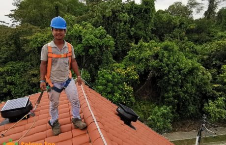 Professional Roofer install turbine solar ventilation fan safety work at height sembawang hill hot weather